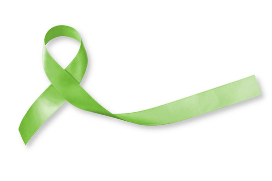 Lymphoma Cancer Awareness Lime Green color ribbon isolated on white background, clipping path: Satin fabric loop symbolic logo raising support help people life living with tumor illnesss