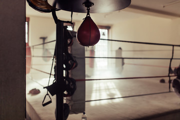 Empty boxing ring with speed bag in foreground