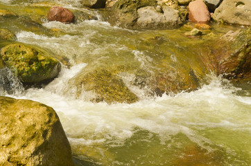 Flowing river water with bubbles photo