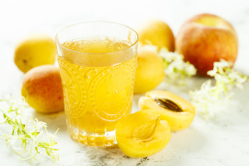 Glass of peach and apricot drink