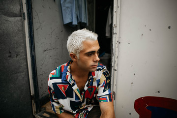 Man with bleached hair looking away