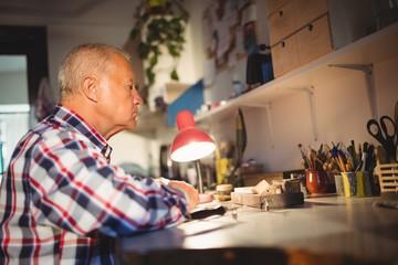 Goldsmith working in workshop