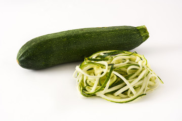 Delicious zucchini noodles isolated on white background