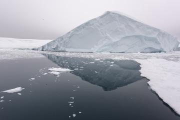 huge icebergs are on arctic ocean in Greenland