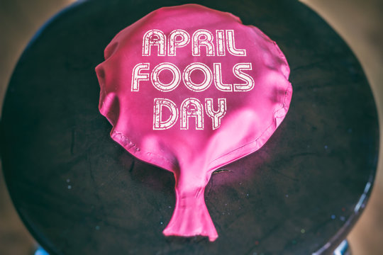 Whoopie Cushion April Fools Day. Whoopie cushion on a chair with the words April Fools Day printed on it.
