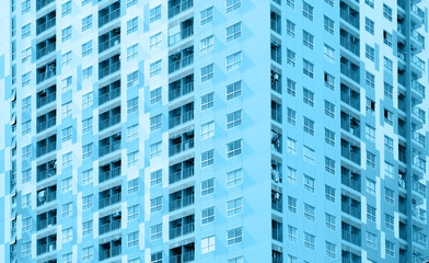 Apartment building / View of balconies of apartment building. Blue tone.