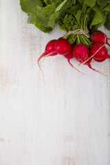 Radish with leaves on a wooden table