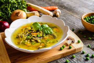 Mushroom soup with carrot, pea, kale, parsley, celery and onion