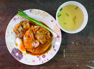 Khao Moo Dang or barbuced red pork in sauce with rice. A single