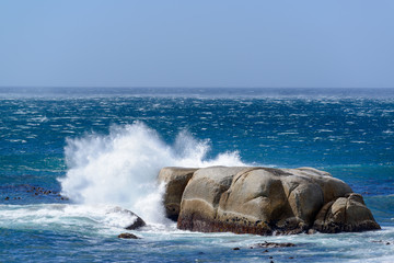 Wave crashing into rock at sea during a storm. Cape Town. Western Cape. South Africa