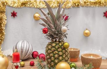 Alternative decorated Christmas tree surrounded by pineapple Christmas decorations