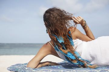 Beautiful young bohemian woman on beach