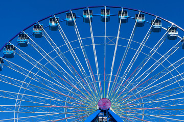 Ferris wheel with blue sky in the background