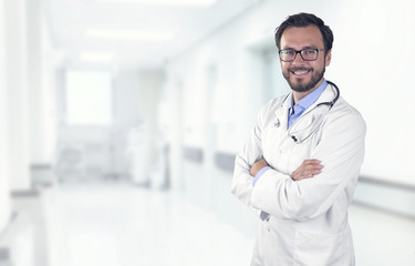 smiling doctor in hospital with copy space