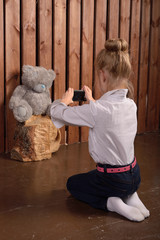 Little girl photographer, first picture toys