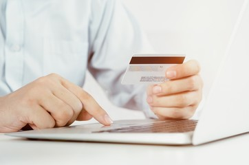 Man with laptop using credit card. Internet shopping.
