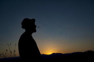 Young man in sunset