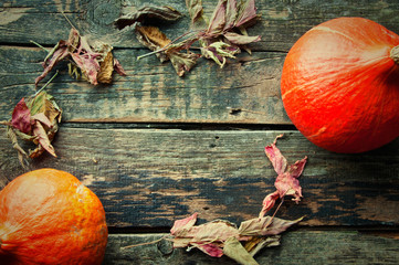 Pumpkins on an old wooden table from above. text space