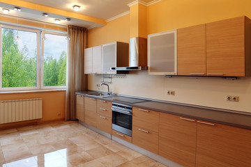 Luxury kitchen interior with orange walls , stone floor and fore