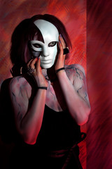 girl with zombie makeup on body and white mask