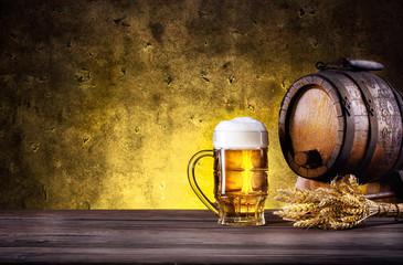 Mug of beer with foam and barrel