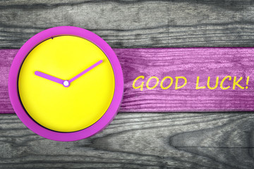 Good Luck message and clock on table