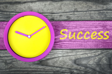 Success message and clock on table