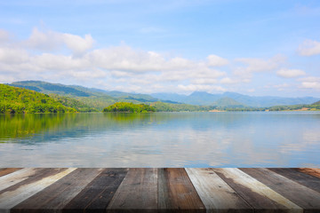 Wooden table and lake landscape
