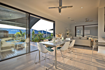 Dinner on the wooden floor with a glass door entrance