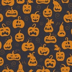 Seamless pattern on the theme of Halloween, different shapes orange pumpkins on a dark background