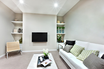 Television on the wall in a luxury living room