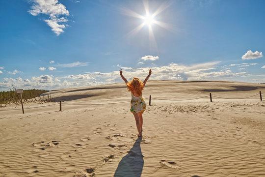 Happy Woman against Sand Dunes in Leba, Poland