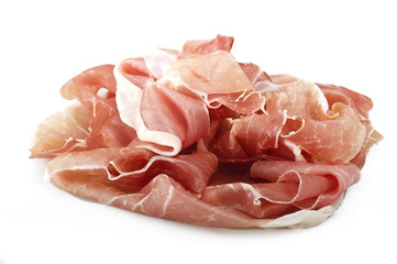 Italian prosciutto crudo ,raw ham leg sliced on white