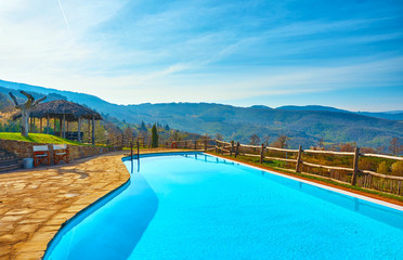 Outdoor swimming pool in the countryside with views of the hills