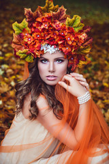 Young Attractive Woman With Handsome Flower Wreath