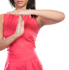 Mixed race woman showing time out gesture sign.