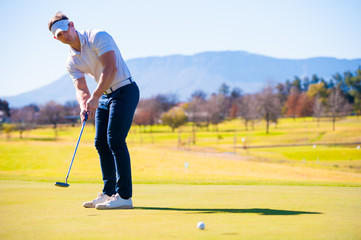 view of a golfer planning his shot to the pin
