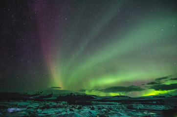 Northern lights over the ice lagoon, Iceland
