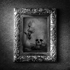 Vintage photo frame, photo of skull with rose over grunge background, Halloween concept, black and white