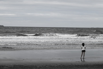 lonely girl on the beach (black-white tone)
