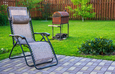 Lounge chair in yard of a country house