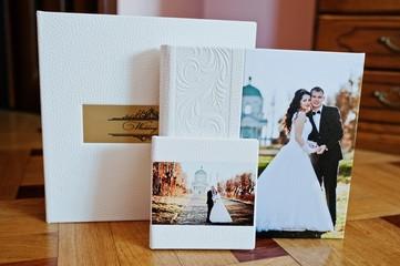 White leather wedding book or wedding album on wooden background