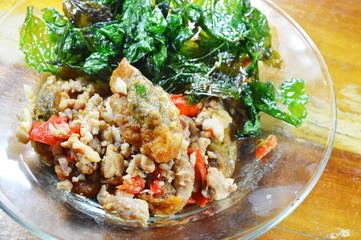 stir fried crispy basil leaf with black preserved egg and minced pork