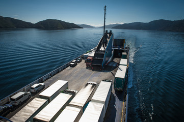Ferry loaded with trucks and cars traveling from Wellington to Picton via Marlborough Sounds, New Zealand