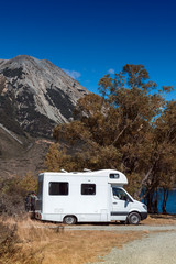 Motorhome camper at Lake Pearson / Moana Rua Wildlife Refuge located in Craigieburn Forest Park in Canterbury region, South Island of New Zealand