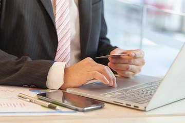 Businessman doing online banking.