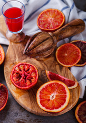 blood orange,freshly squeezed orange juice,on a wooden Board.selective focus.