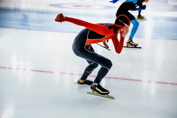 competition athletes skating in sprint race in speed skating