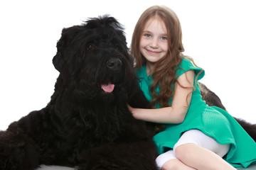 Girl stroking a dog