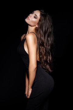 Beautiful sexy woman in black evening dress